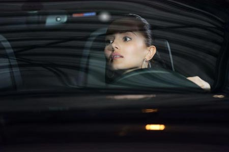 Woman driving at night - Copyright: Kirill Polovnoy